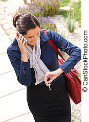 Woman calling rushing arriving home business phone - Woman...