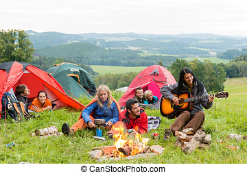 Camping students listening girl with guitar tents - Campers...