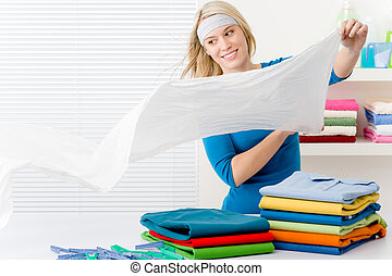 Laundry - woman folding clothes home