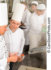 Professional kitchen chef cook add spice food - Professional...