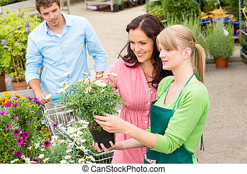 Garden center florist selling flowers to couple - Florist at...