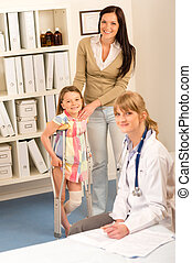 At the pediatrician little girl with crutches - Little girl...