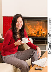 Coffee break woman hot drink at home - Young woman enjoying...