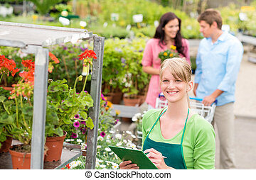 Florist at garden centre retail inventory - Female florist...