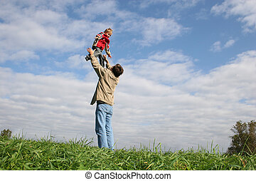 fly child on fathers hands
