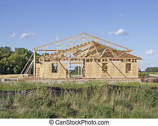A building framed during construction - A large building...