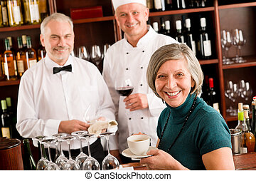 Restaurant smiling manager with staff wine bar - Restaurant...