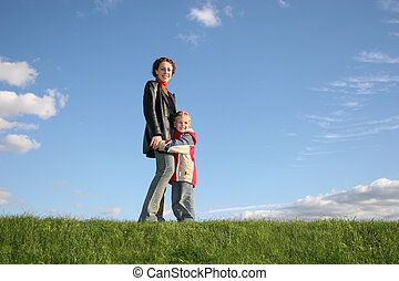 mother with son on grass