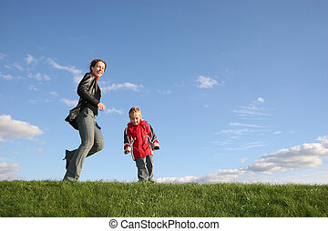 mother with son play on grass