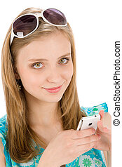 Teenager woman with mobile phone in summer