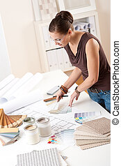 Young female designer working with color swatches - Young...