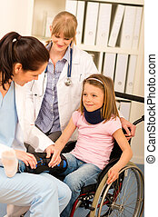 Young girl on wheelchair visit doctor - Little injured girl...