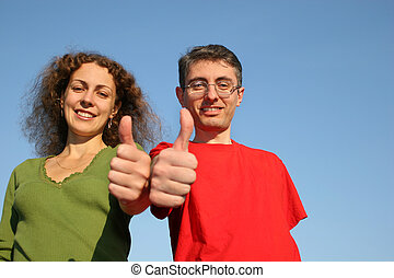 couple with OK fingers