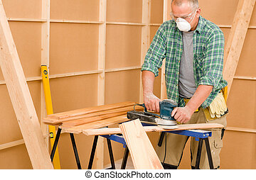 Handyman sanding wooden board diy home renovation - Handyman...