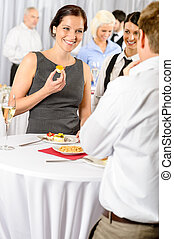 Business woman eat dessert from catering service during...
