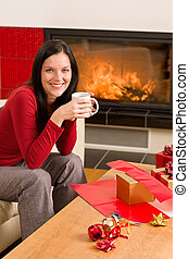 Christmas present wrap woman drink home fireplace - Happy...