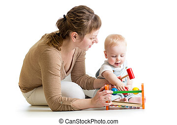 baby boy and mother playing together with toy
