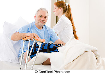 Hospital - female nurse care patient broken leg - Hospital -...