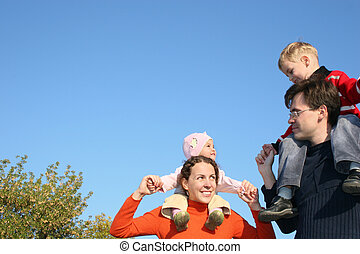 family with children on shoulders