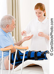 Hospital - female nurse pill patient broken leg - Hospital -...