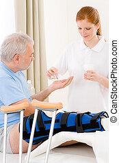 Hospital - female nurse pill patient broken leg - Hospital -...