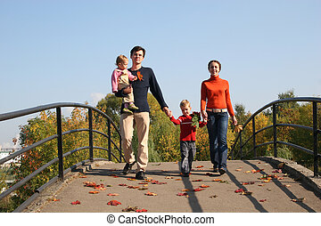 family of four on bridge