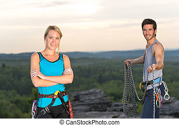 Rock climbing active people on top sunset - Active young...