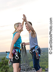 Rock climbing cheerful alpiners on top sunset - Rock...
