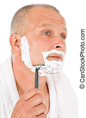 Male cosmetics - Mature man shaving his beard - Portrait of...