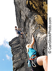 Rock climbing male instructor woman hang rope - Rock...