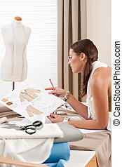 Fashion designer working at studio
