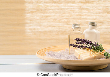 Natural spa products lavender on wooden tray