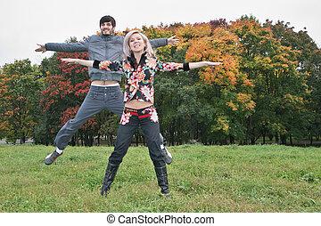 autumn couple jump