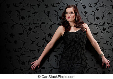 Cocktail party woman evening dress on black background