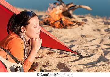 Camping happy woman relax in tent by campfire - Camping...
