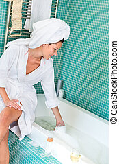 Young woman playing foam bathroom bubblebath hygiene - Young...