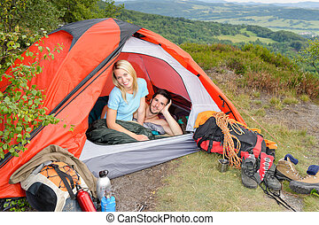 Camping young couple sunset tent climbing gear - Camping...
