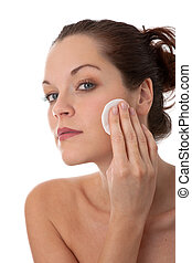 Body care series - Young woman removing make-up - Young...