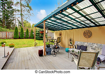 Patio pergola design - Wood patio pergola with iron table...
