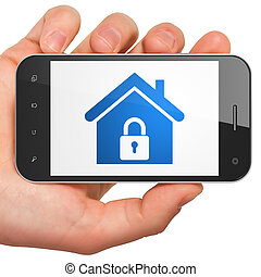 Finance concept: Home on smartphone - Finance concept: hand...