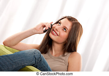 Student series - Young brunette with mobile phone