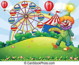A hilltop with a clown and an amusement park