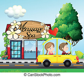 A couple riding in a car near the massage spa