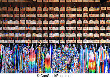Origami cranes and prayer tablets at Fushimi Inari Shrine in...