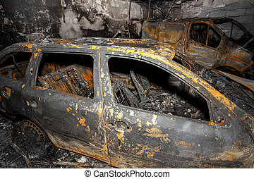 Close up photo of a burned out cars