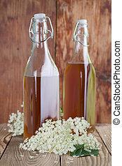 Elderberry syrup - Bottles with freshly made elderberry...