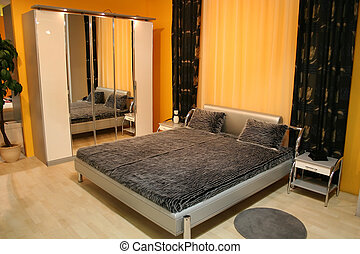 bedroom with mirror closet