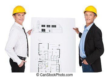 two orlder workers showing plan. site illustration created...