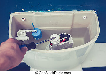 Hand fixing toilet - Hand is fixing a toilet cistern at home