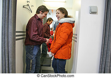 family in fitting-room